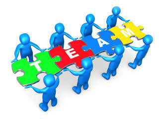 "Team Of 8 Blue People Holding Up Connected Pieces To A Colorful Puzzle That Spells Out ""Team,"" Symbolizing Excellent Teamwork, Success And Link Exchanging Clipart Illustration Graphic"